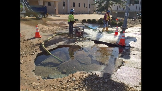 Water main break affecting traffic at busy downtown intersection
