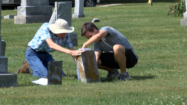 Local students help replace damaged gravestones