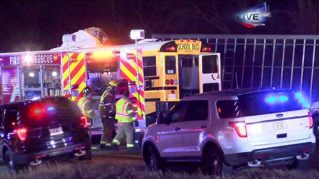 Two adults dead, Normal West students in stable condition after bus vs. semi crash